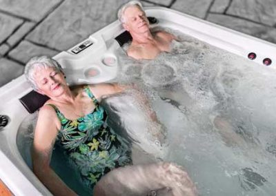An eldery couple relaxing in the hot tub